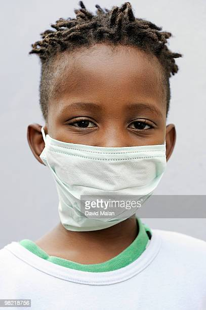 Boy wearing surgical mask, Cape Town, Western Cape Province, South Africa