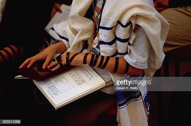 boy wearing tefellin - jewish prayer shawl stock pictures, royalty-free photos & images