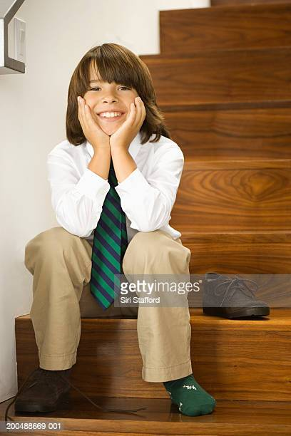 boy (8-10) wearing tie, sitting on steps - shirt and tie stock pictures, royalty-free photos & images