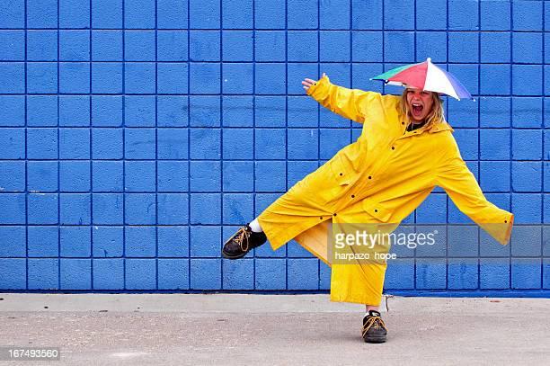Boy wearing umbrella hat and raincoat