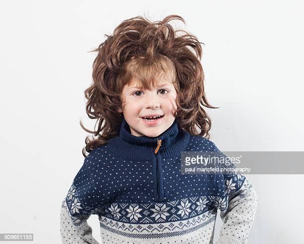 Boy wearing wig