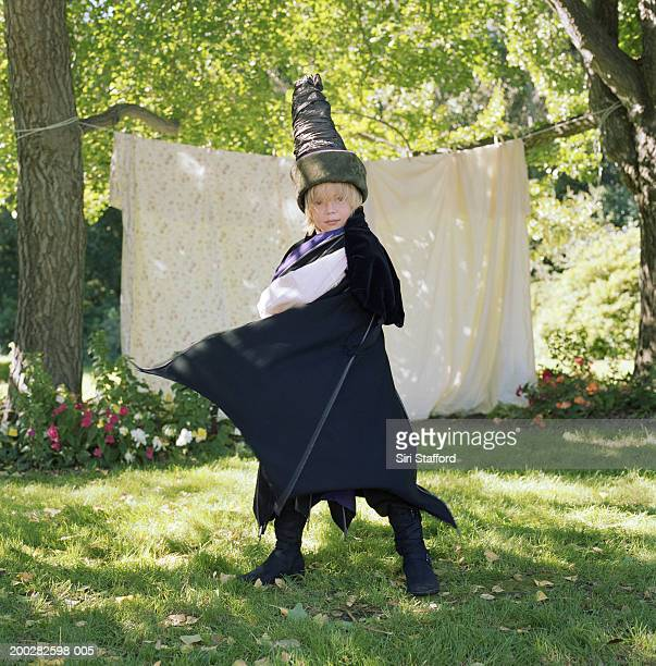 Boy (7-9) wearing wizard costume with cape