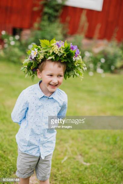 boy wearing wreath - midsommar stock pictures, royalty-free photos & images