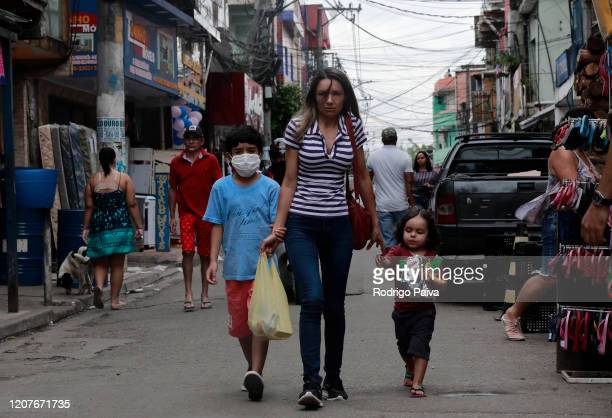A boy wears a face mask at the Paraisopolis favela on March 19 2020 in Sao Paulo Brazil Paraisopolis is the second largest favela in the city of Sao...