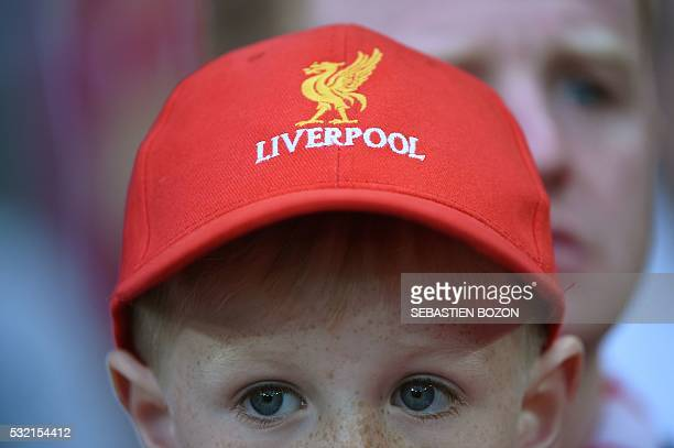 A boy wears a Liverpool cap as he attends the UEFA Europa League final football match between Liverpool FC and Sevilla FC at the St JakobPark stadium...
