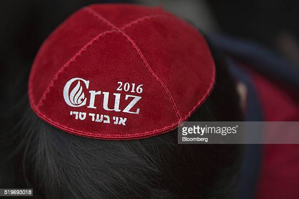 A boy wears a yarmulke in support of Senator Ted Cruz a Republican from Texas and 2016 presidential candidate at a campaign stop at the Jewish Center...