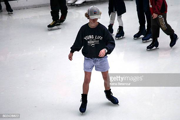 A boy wears shorts while ice skating at the rink at Rockefeller Center on December 24 2015 in New York City New York City has seen highs in the upper...