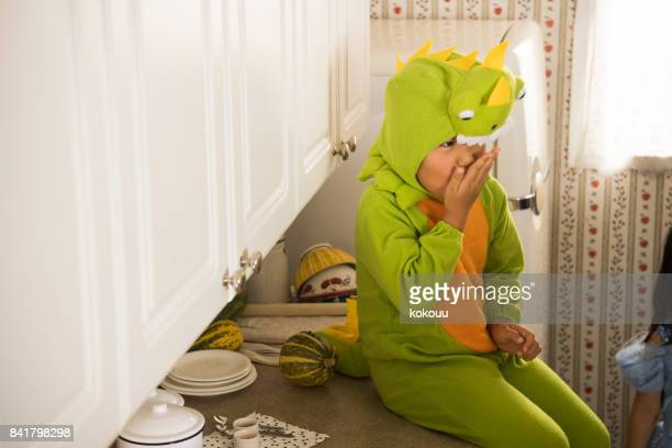 a boy who eats sweets in the kitchen. - girl sitting on boys face stock photos and pictures