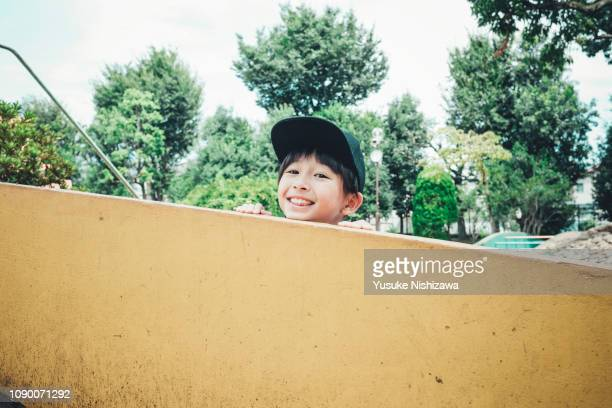 a boy who laughs at the camera - yusuke nishizawa bildbanksfoton och bilder