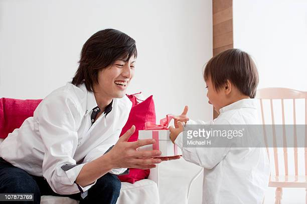 Boy who passes present to father