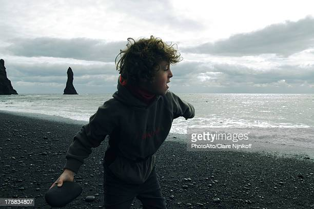 Boy who ricochets on the beach Iceland