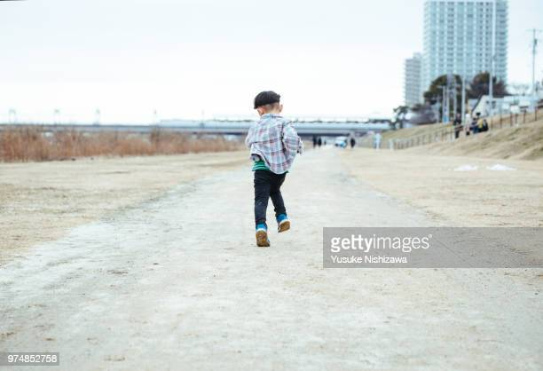 a boy who runs - yusuke nishizawa stock pictures, royalty-free photos & images