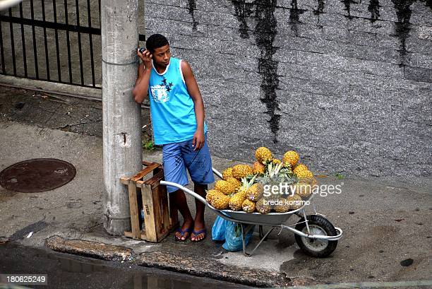 CONTENT] Boy who sells pineapples on the street in Urca Rio de Janeiro Brazil April 5 2013