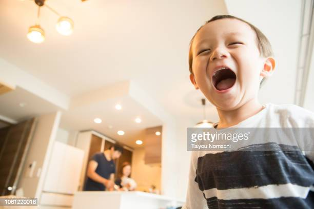 a boy who smiles loud - childhood stock pictures, royalty-free photos & images