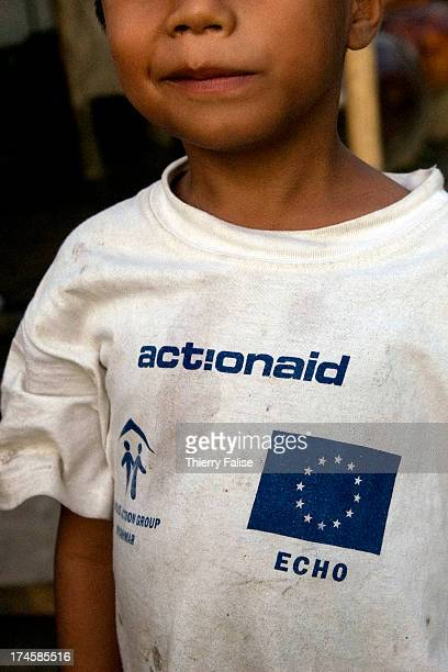 A boy who survived cyclone Nargis wears a tshirt reading names of relief and international agencies Actionaid and Echo According to official figures...