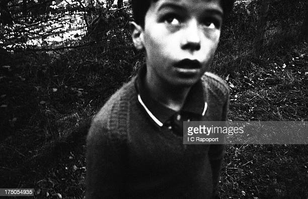 A boy who survived the avalanche after a colliery spoil heap collapsed and killed 116 children and 28 adults stares into space in November 1966 in...