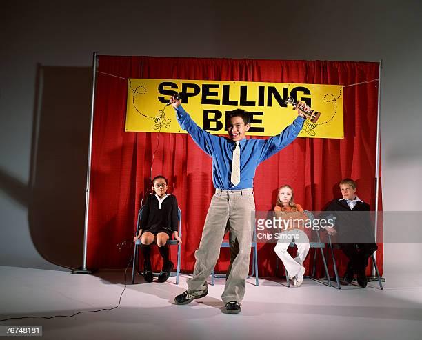 Boy winning spelling bee