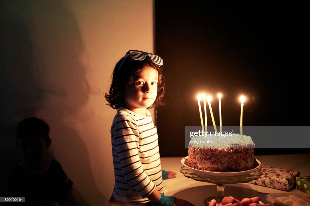 Birthday Cake For 5 Year Boy ~ Boy with year old birthday cake stock photo getty images