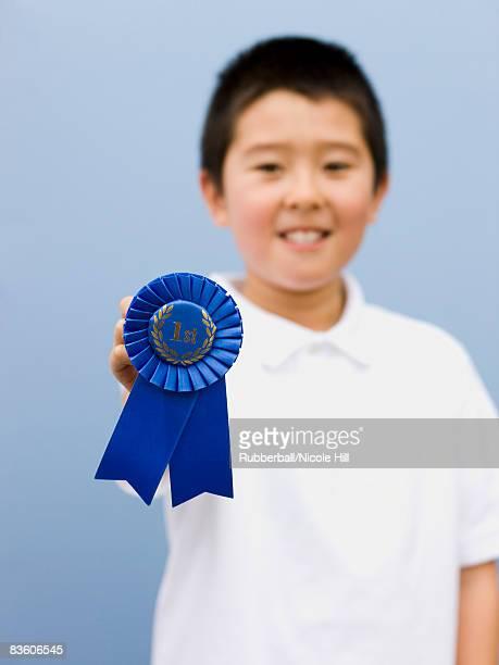 boy with a blue ribbon