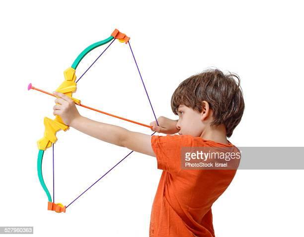 Boy with a bow and arrow
