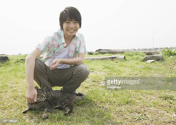 Boy with a cat in the field