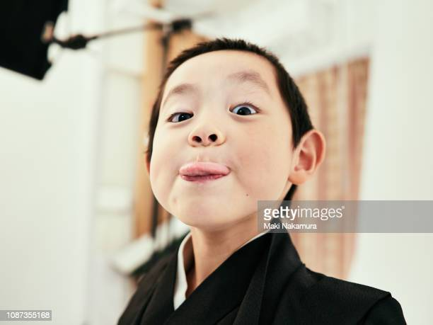 a boy with a challenging look towards the camera - snapping the ball stock pictures, royalty-free photos & images