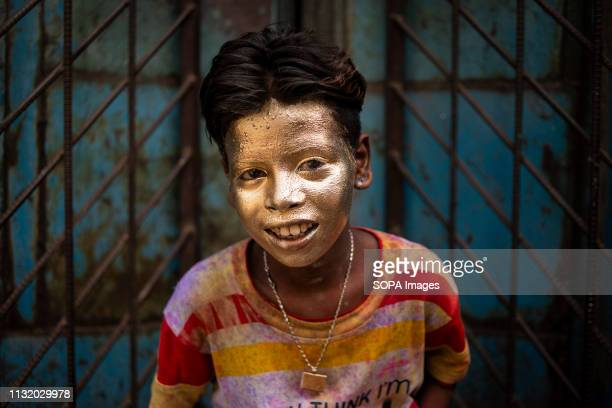 A boy with a coloured face seen posing for a photo during the celebration Holi known as the festival of colour is an ancient Hindu spring festival...