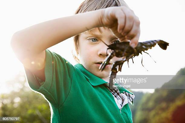 boy with a crawfish in his hands