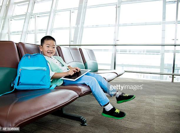 Boy with a digital tablet at the airport
