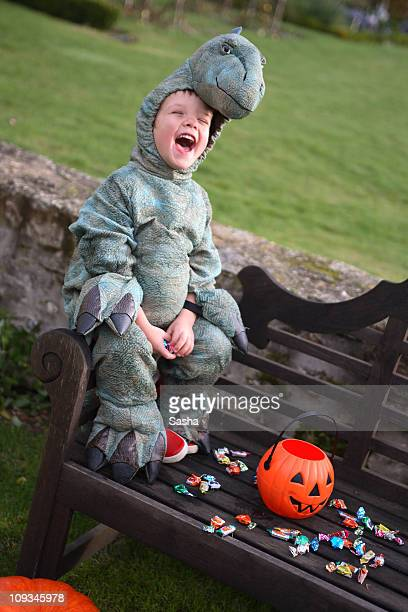 boy with a dinosaur costume for halloween
