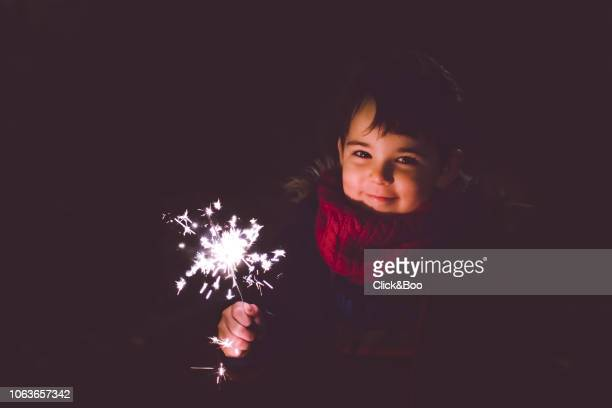 Boy with a flare with a black background