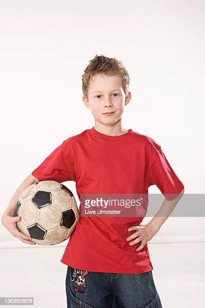 Boy with a football under his arm