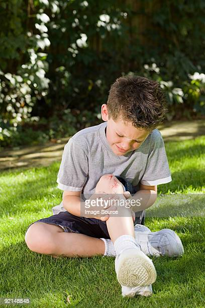 boy with a grazed knee - leg wound stock pictures, royalty-free photos & images