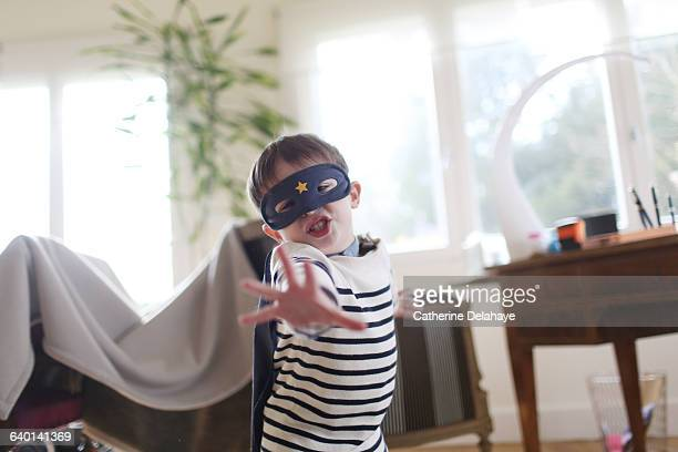 A boy with a mask playing at home