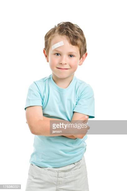 boy with a plaster on his forehead