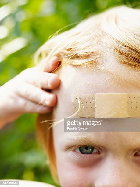A boy with a plaster on his forehead Sweden.