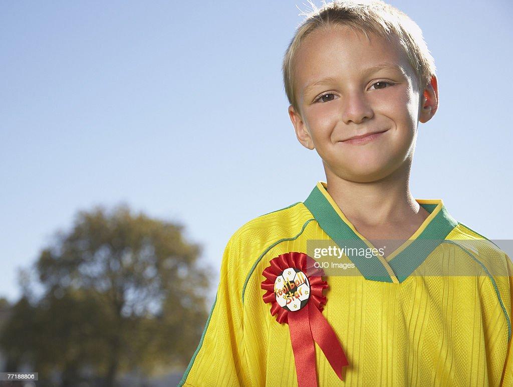 Un niño con una cinta : Foto de stock