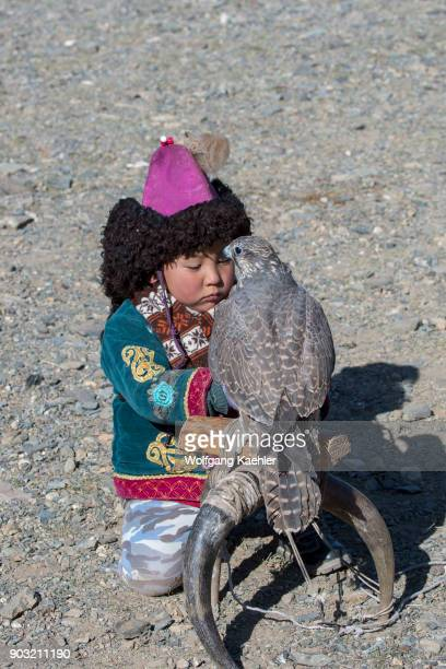 A boy with a saker falcon at the Golden Eagle Festival near the city of Ulgii in the BayanUlgii Province in western Mongolia
