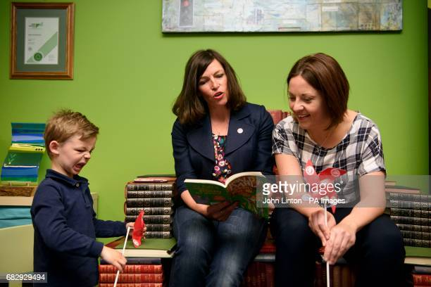 A boy with a Scottish Labour Party toy windmill listens to Dunfermline and West Fife candidate Cara Hilton reading with Scottish Labour leader Kezia...