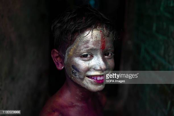 A boy with a silver painted face seen posing for a photo during the celebration Holi known as the festival of colour is an ancient Hindu spring...