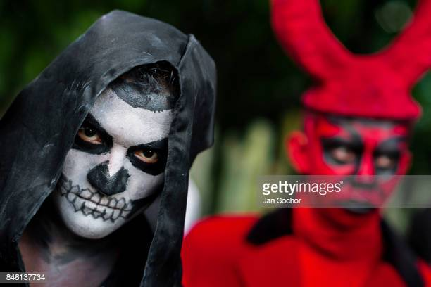 A boy with a skull paint takes part in the Calabiuza parade during the Day of the Dead festival on November 01 2016 in San Salvador El Salvador Day...