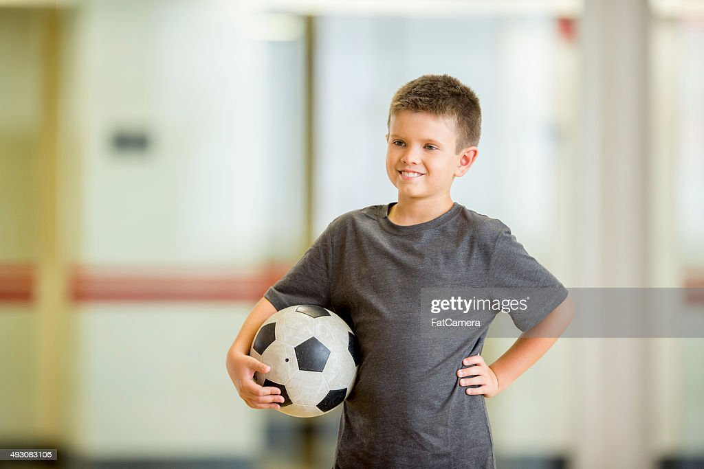 Boy with a Soccer Ball : Stock Photo