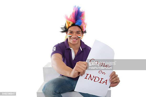 Boy with a wig cheering