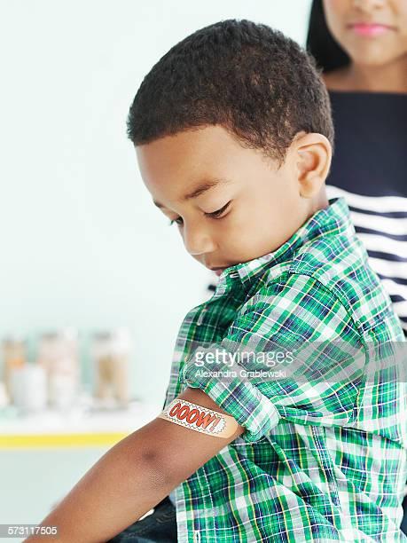 Boy with adhesive bandage on arm