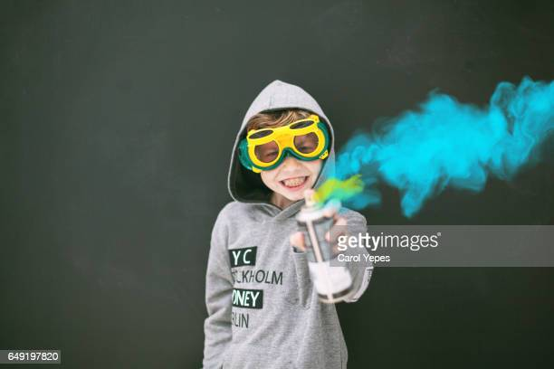 boy with aerosol paint looking at camera - street artist stock photos and pictures