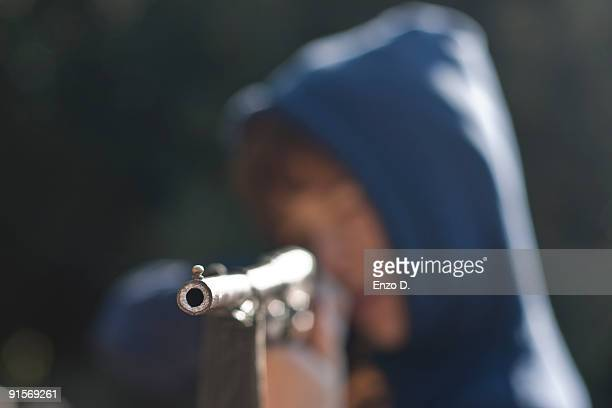 Boy with air rifle shooting