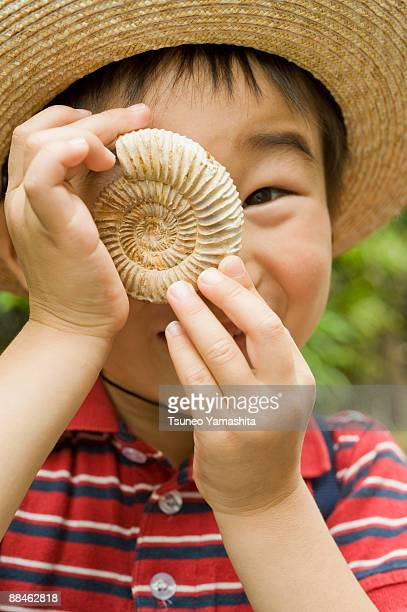 Boy with ammonite