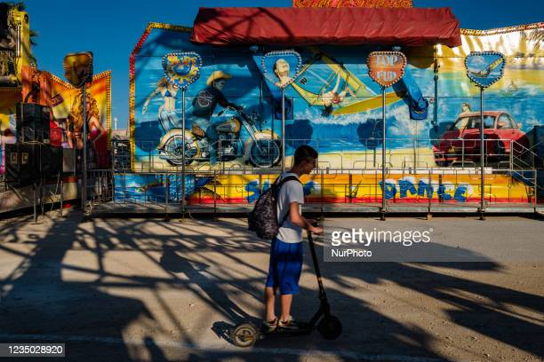 Boy with an electric scooter among the rides at the Luna Park at Secca dei Pali in Molfetta, on 2 September 2021. On the occasion of the patronal...