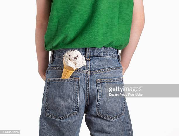 A Boy With An Ice Cream Cone In His Back Pocket