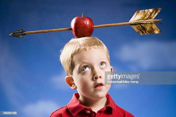 Boy with apple and arrow on head